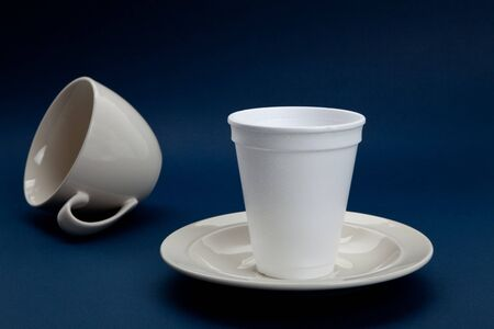 presumptuous: Disposable Cup and Coffee Cup, concept of wrong position Stock Photo
