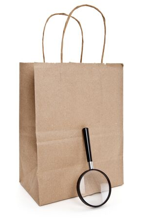 Brown paper shopping bag and Magnifier Stok Fotoğraf