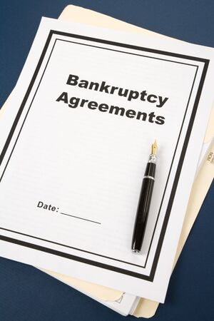 Bankruptcy Agreement and pen, business concept  Фото со стока