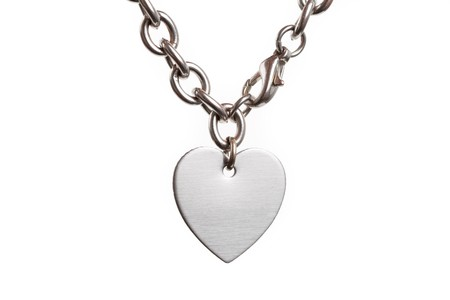 shiny metal background: Chain and Heart Shape close up