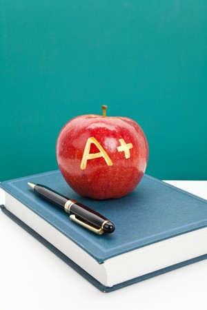 Red apple and Textbook close up photo