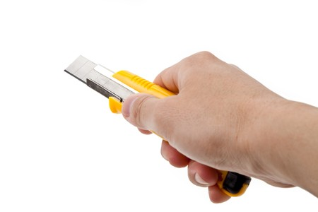 cutter: Hand Holding a Cutter Knife, white background