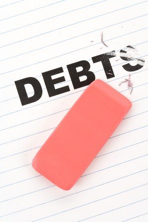 reducing: eraser and word debt, concept of Reduce Debt Stock Photo