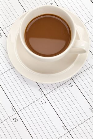 Coffee cup and Calendar close up