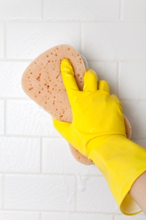 yellow: Cleaning Bathroom Tile Wall close up