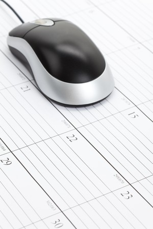 Computer Mouse and Calendar close up Stok Fotoğraf