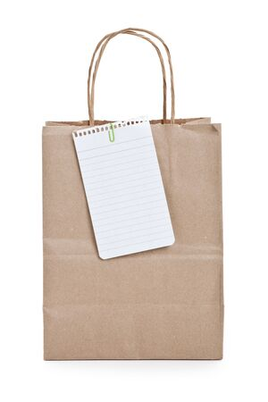 Brown paper shopping bag and note paper photo