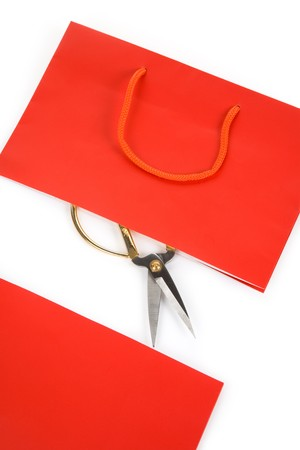 consumer: Shopping Bag and scissor, concept of consumer confidence fall