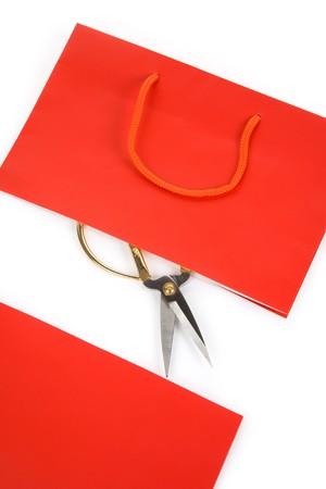 Shopping Bag and scissor, concept of consumer confidence fall Banco de Imagens - 7431453