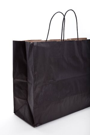 Black paper shopping bag with white background Фото со стока