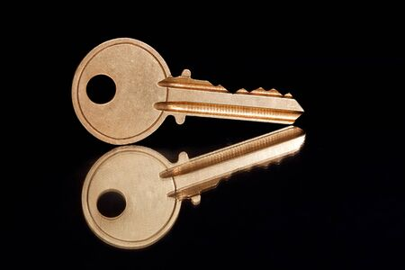 Golden House Key with black background