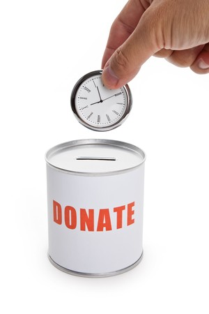Donation Box and clock, Concept of time to donate or donate your time. photo