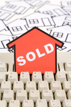 a red home sign and computer keyboard,  Real Estate Concept  Stock Photo - 7497455