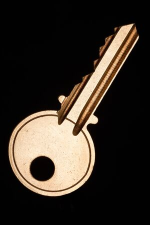 Golden House Key with black background photo