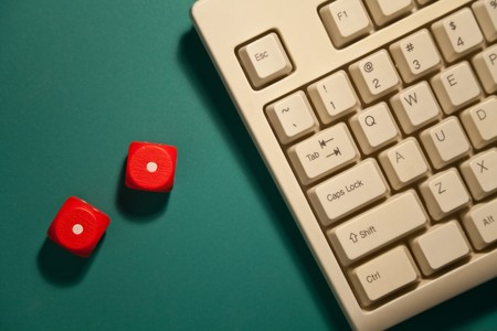 Red Dice and computer keyboard, concept of gambling
