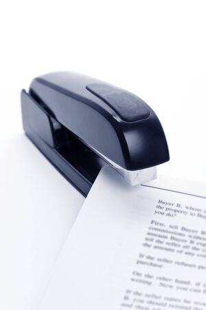 office stapler: Black Stapler and document close up