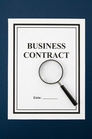 Business Contract and Magnifying Glass, business concept