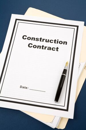 business contract: Construction Contract and pen close up Stock Photo