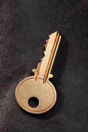 Golden House Key with black background photo