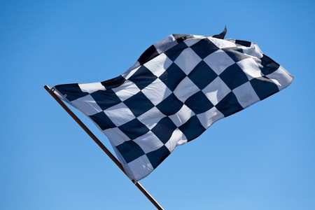 winning flag: Checkered Flag and blue sky