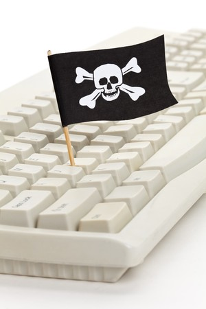 drapeau pirate: Pirate Flag and Computer Keyboard, concept of Computer Hacker