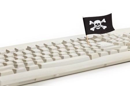 Pirate Flag and Computer Keyboard, concept of Computer Hacker photo