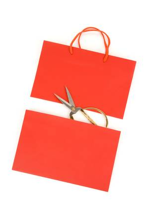Shopping Bag and scissor, concept of consumer confidence fall Banco de Imagens - 7711963