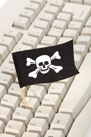 Pirate Flag and Computer Keyboard, concept of Computer Hacker Stock Photo - 7712051