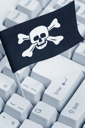 Pirate Flag and Computer Keyboard, concept of Computer Hacker Stock Photo - 7712048