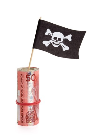 crime: Pirate Flag and Canadian Dollar, concept of business crime Stock Photo