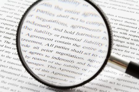 magnifying glass: Magnifying Glass and document close up