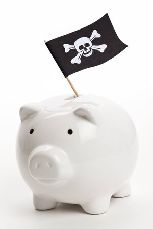 crime: Pirate Flag and Piggy Bank, concept of business crime