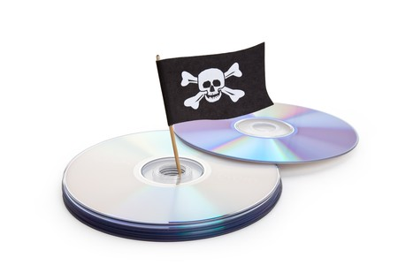 CD, DVD and Pirate Flag, concept of Piracy Stock Photo - 7744998