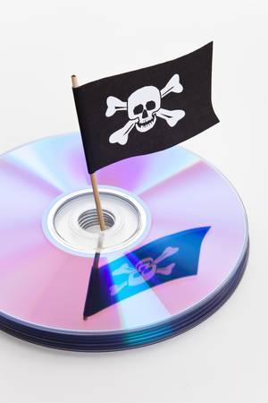 CD, DVD and Pirate Flag, concept of Piracy photo
