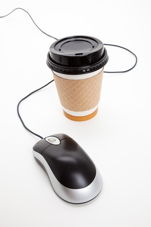 Disposable Coffee Cup and Computer Mouse with white background