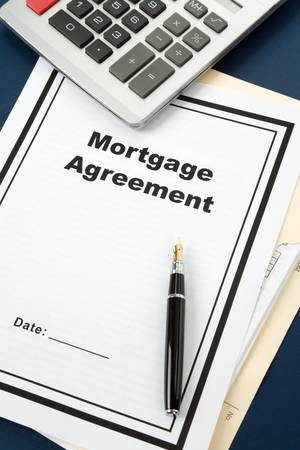 Mortgage Agreement and calculator close up