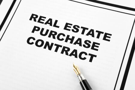 purchase: Real Estate Purchase Contract and pen, business concept