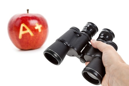 Binoculars and Red Apple, concept of education success Stock Photo - 7805606