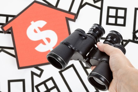 Binoculars and Home Sign, concept of Business success photo