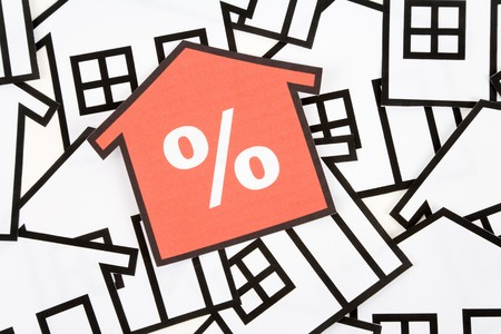 white interest rate: a red home sign,  Real Estate Concept