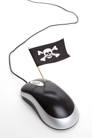 Pirate Flag and Computer Mouse, concept of Computer Hacker Stock Photo - 7870599