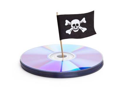 imitations: CD, DVD and Pirate Flag, concept of Piracy