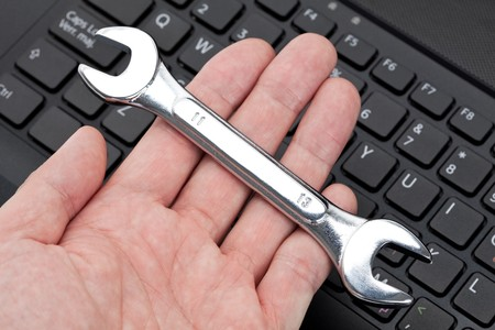 Computer Keyboard and Wrench, concept of IT Support Stock Photo - 7870683