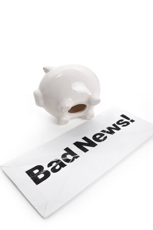 Bad News and Piggy Bank, concept of finance problems photo