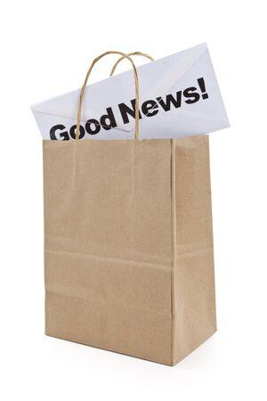 Goed nieuws en boodschappentas, concept van Financiën succes Stockfoto