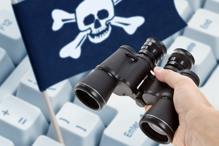 Binoculars and Pirate Flag, concept of Computer Hacker photo