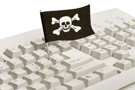 pirate flag: Pirate Flag and Computer Keyboard, concept of Computer Hacker