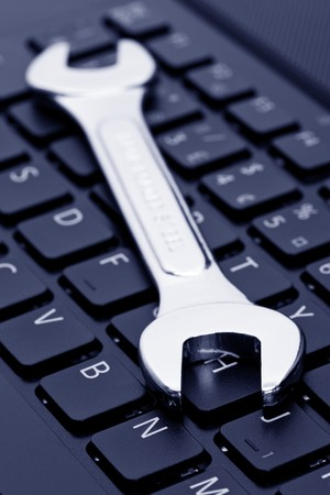 Computer Keyboard and Wrench, concept of IT Support photo