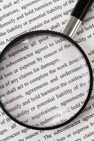 Magnifying Glass and document close up photo