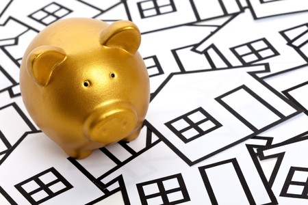 Golden Piggy Bank, Real Estate Concept Stock Photo - 8053793
